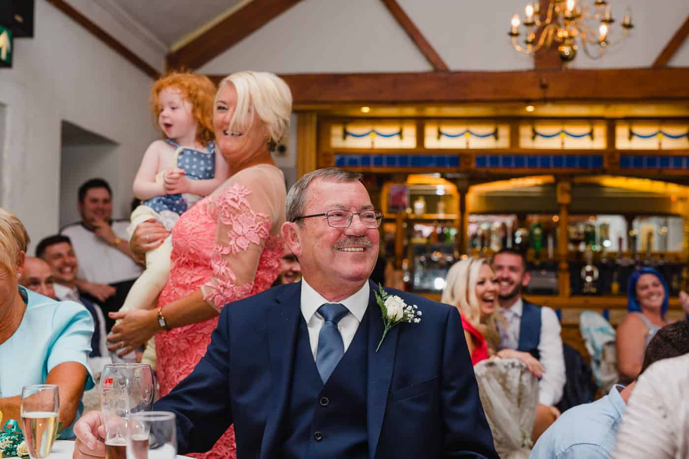 Coach House Wedding guest laughter