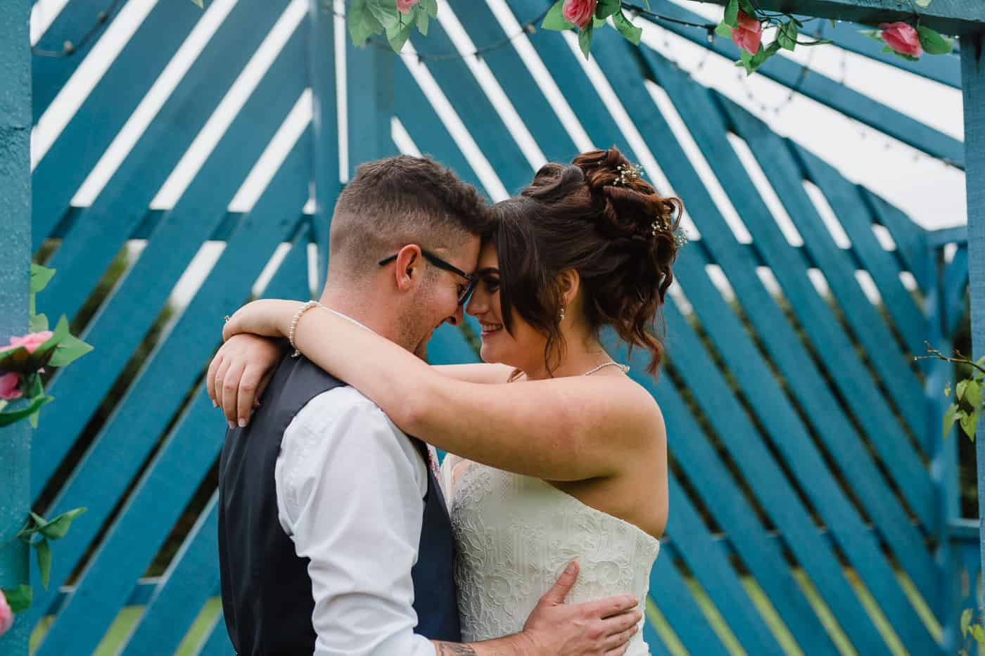 Coach House bride and groom cuddling