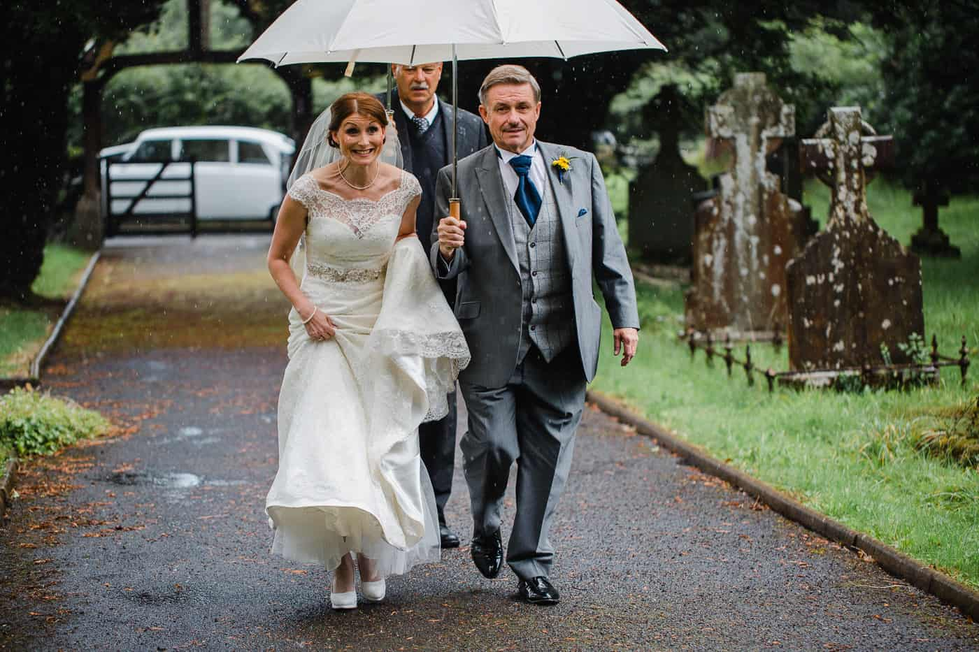 Rainy wedding arrival