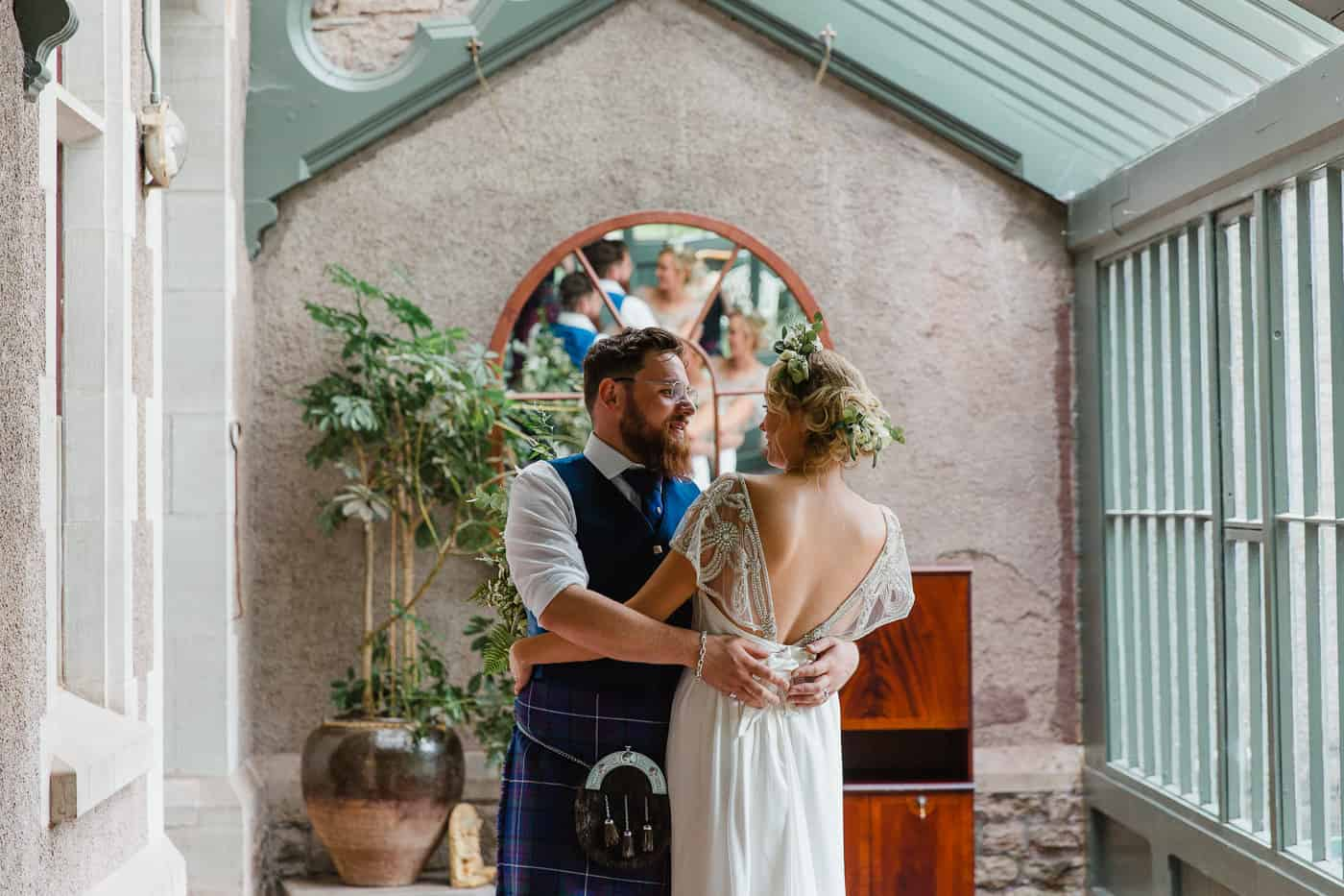 Bride and groom in Derwydd Mansion