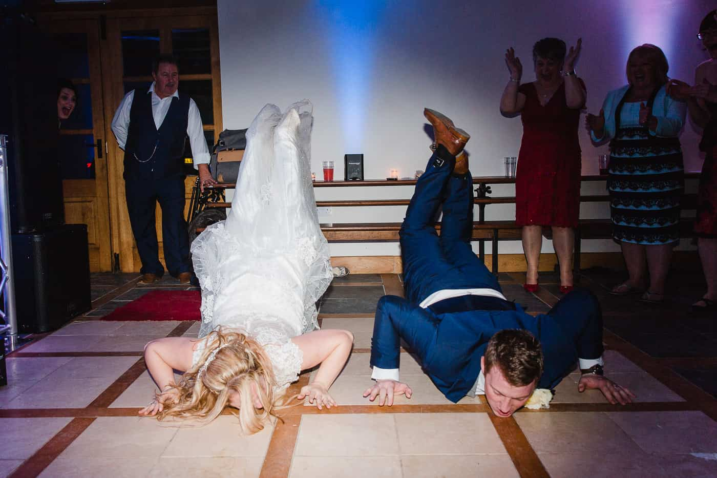 bride and groom doing the worm