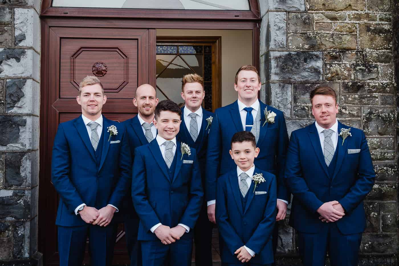 seven people smiling in suits