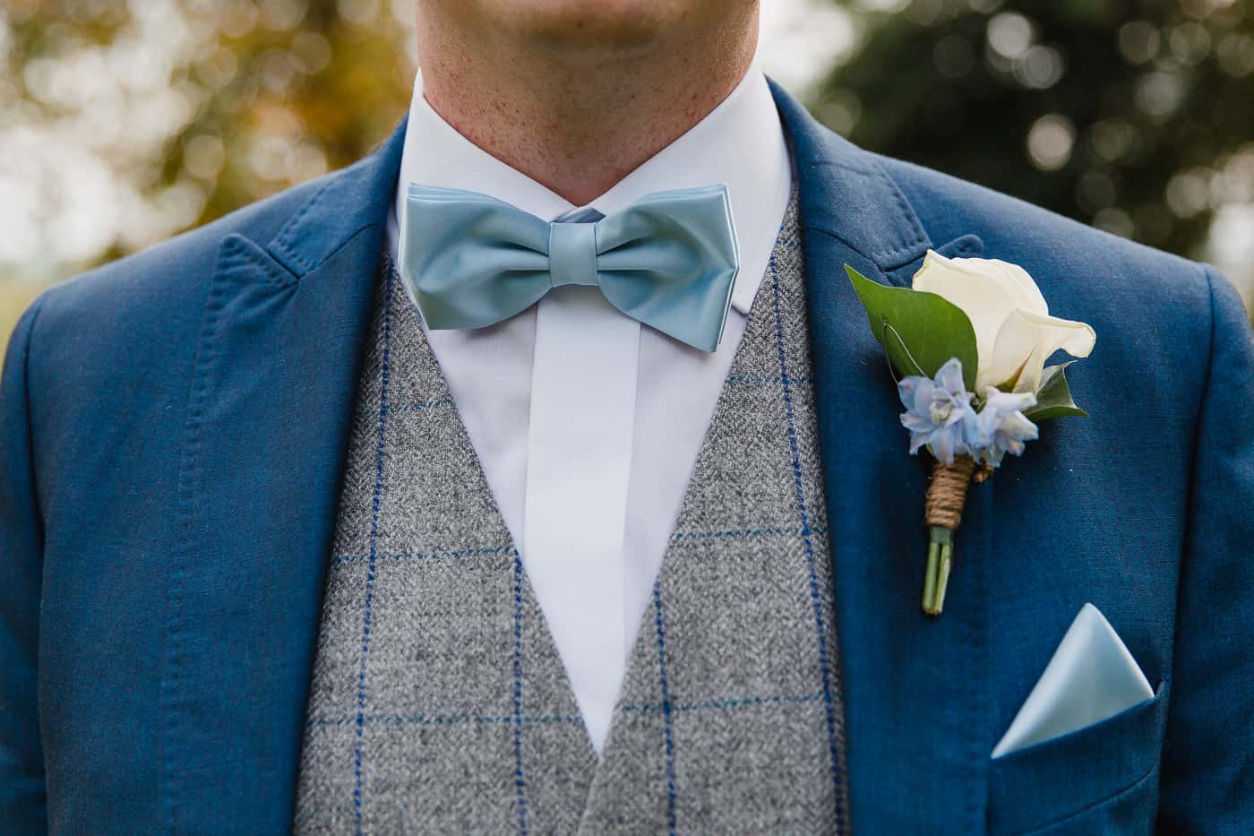 close-up of bow tie and button hole