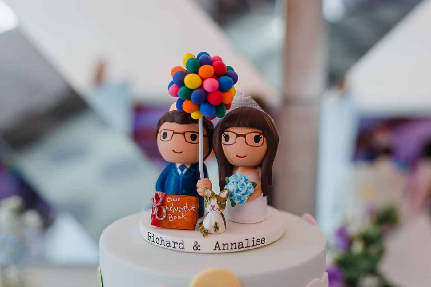 bride and groom cake toppers with balloons