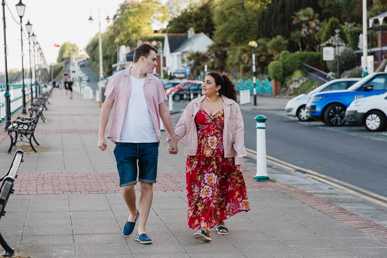 two people walking along a promenade