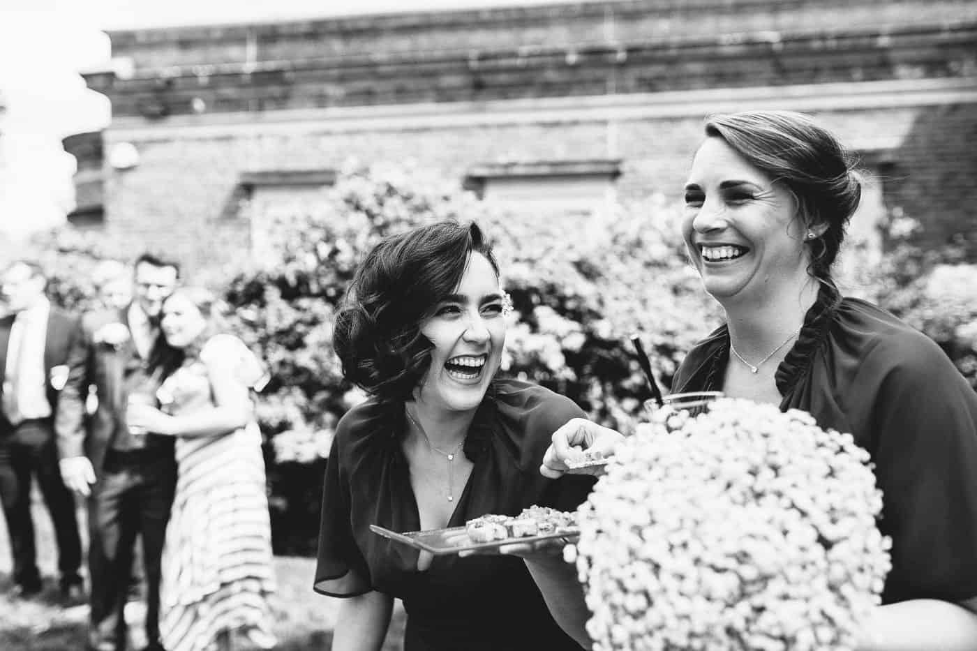 two bridesmaids laughing