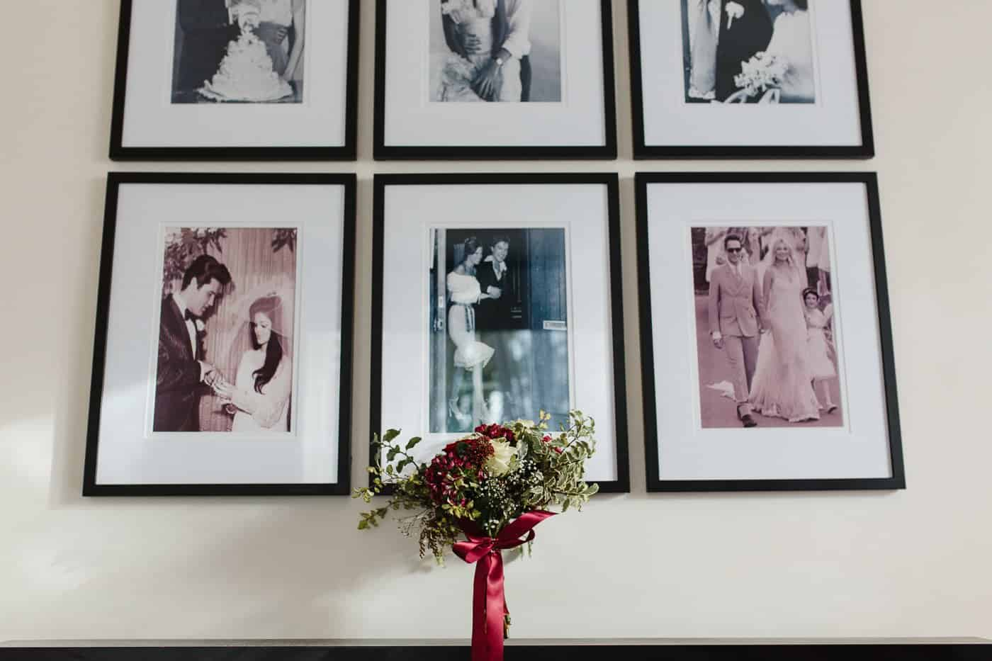 wedding bouquet under picture frames