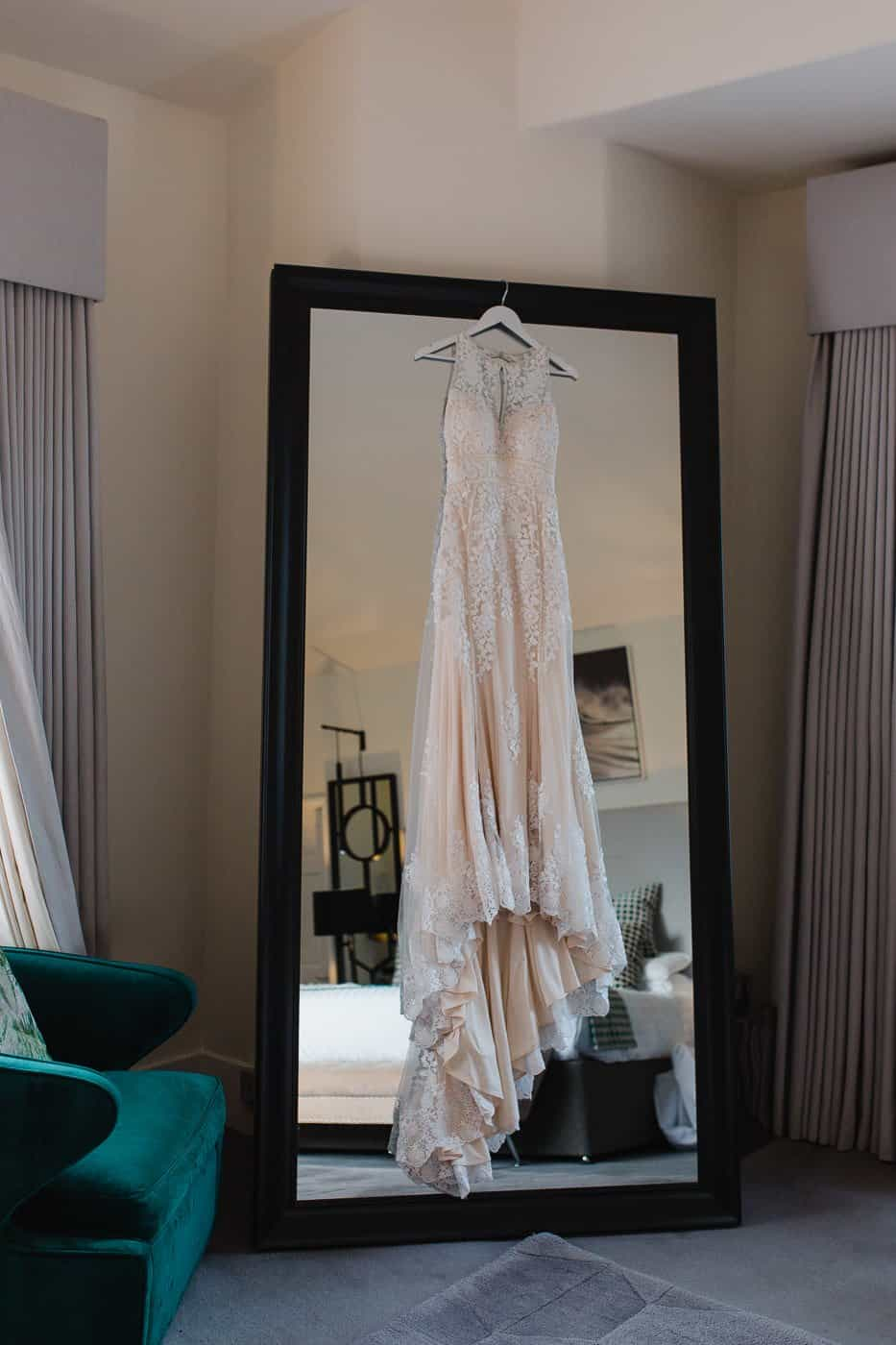 wedding dress hung on mirror