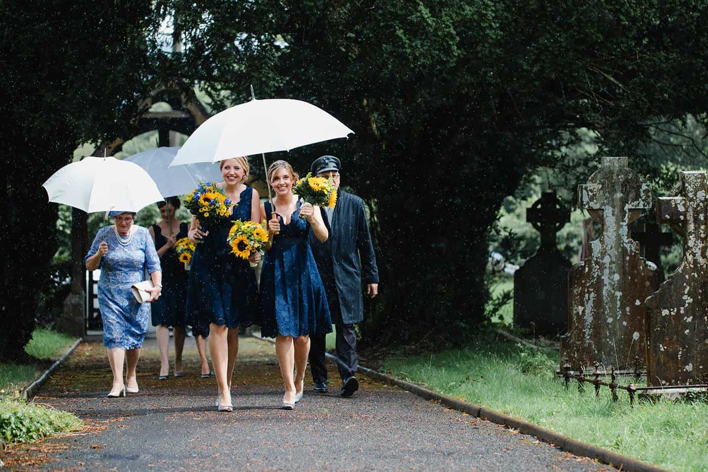 bridesmaids walking in the rain