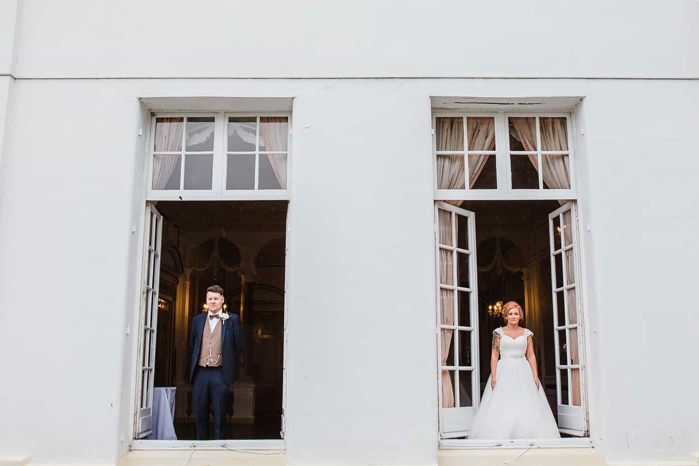 bride and room stood in two windows