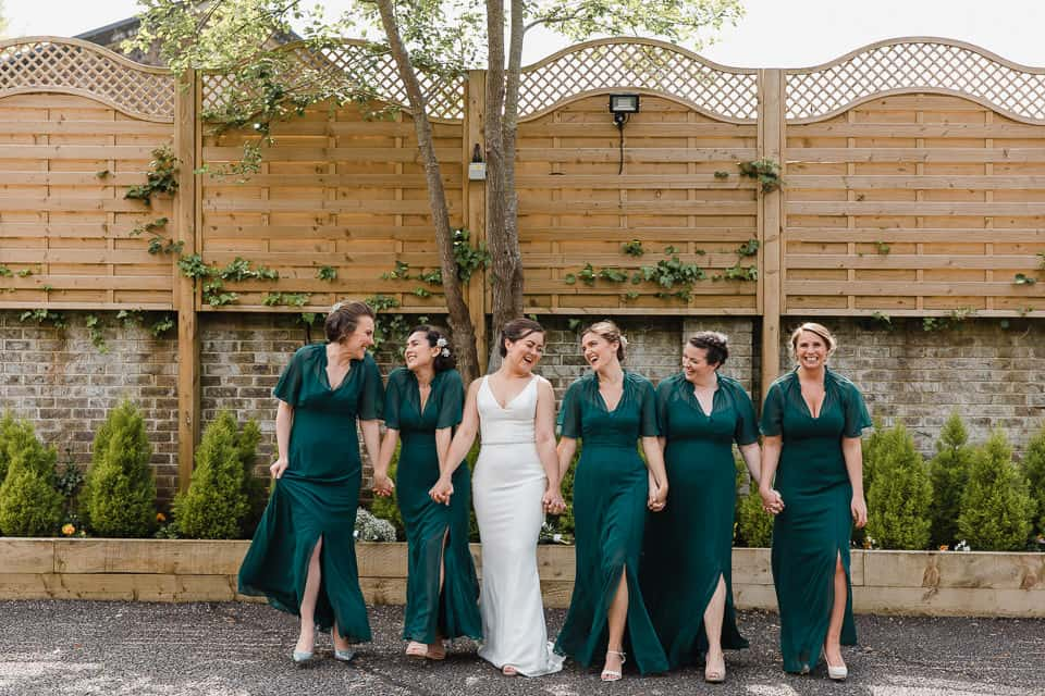 Bride and Bridesmaids laughing Decourceys Manor