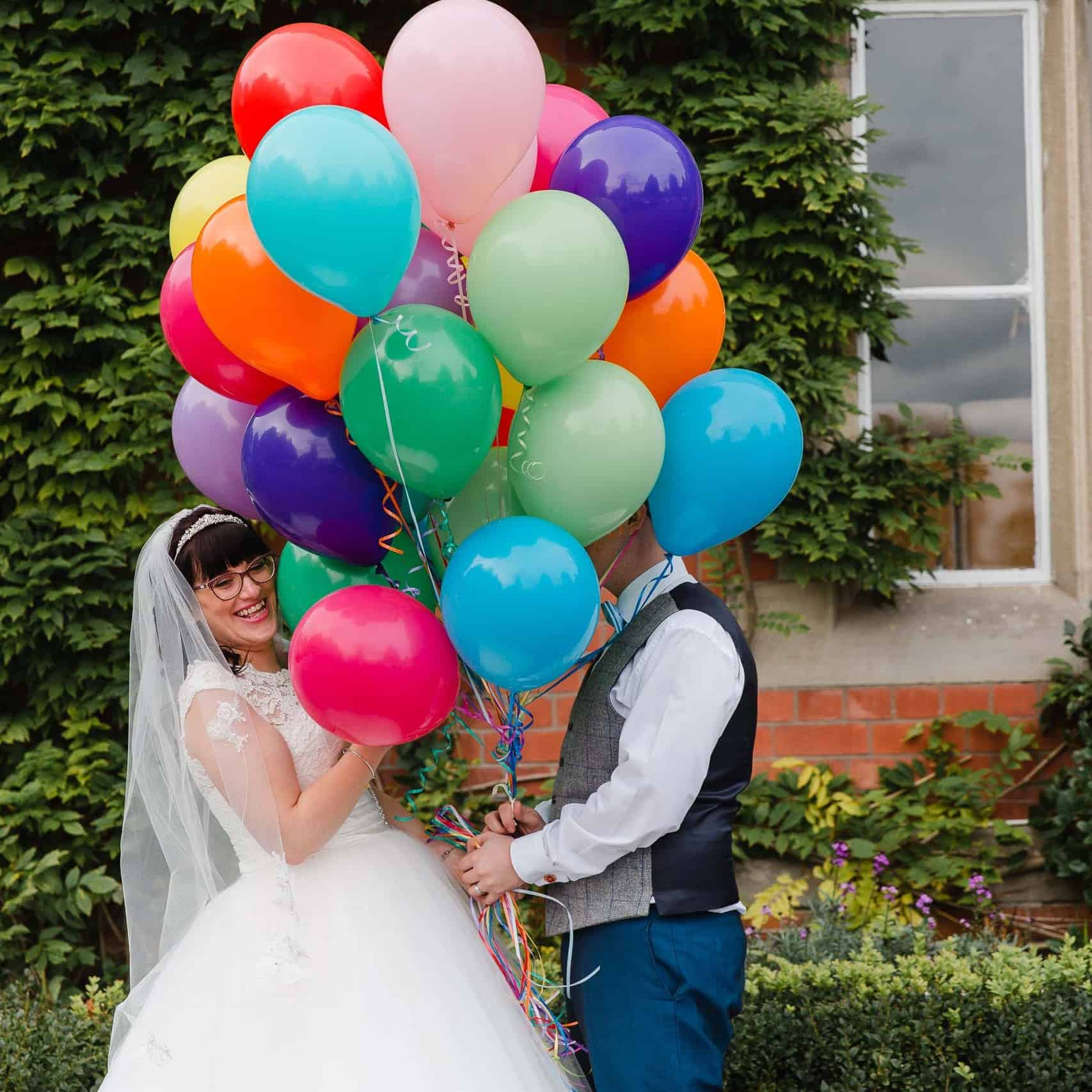 creative wedding photography bride and groom with balloons