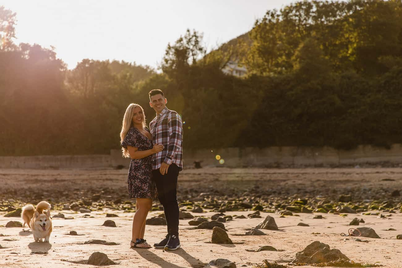 golden hour couples portrait looking at camera at langland bay