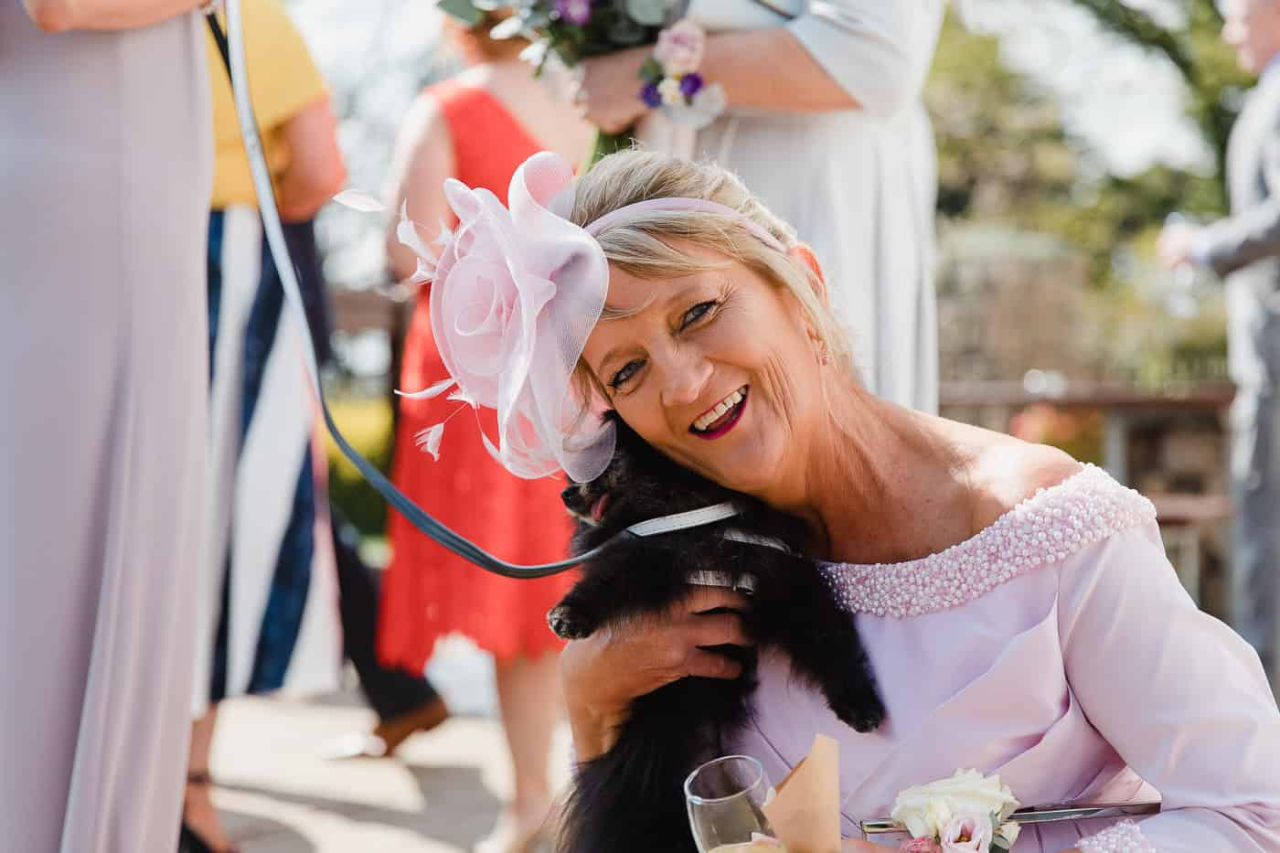 wedding guest and dog smiling candid photography