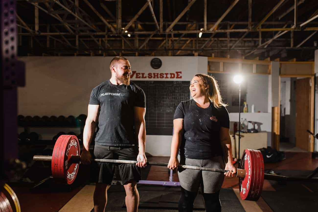 couples alternative engagement portrait weight lifting at gym