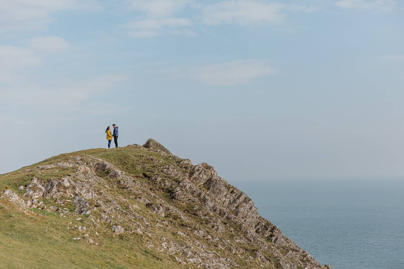 couples on cliff top three cliffs bay