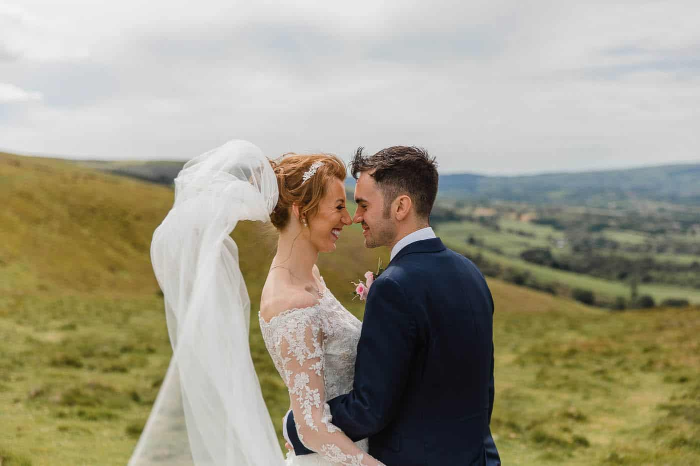 bride and groom portrait on hill top south wales