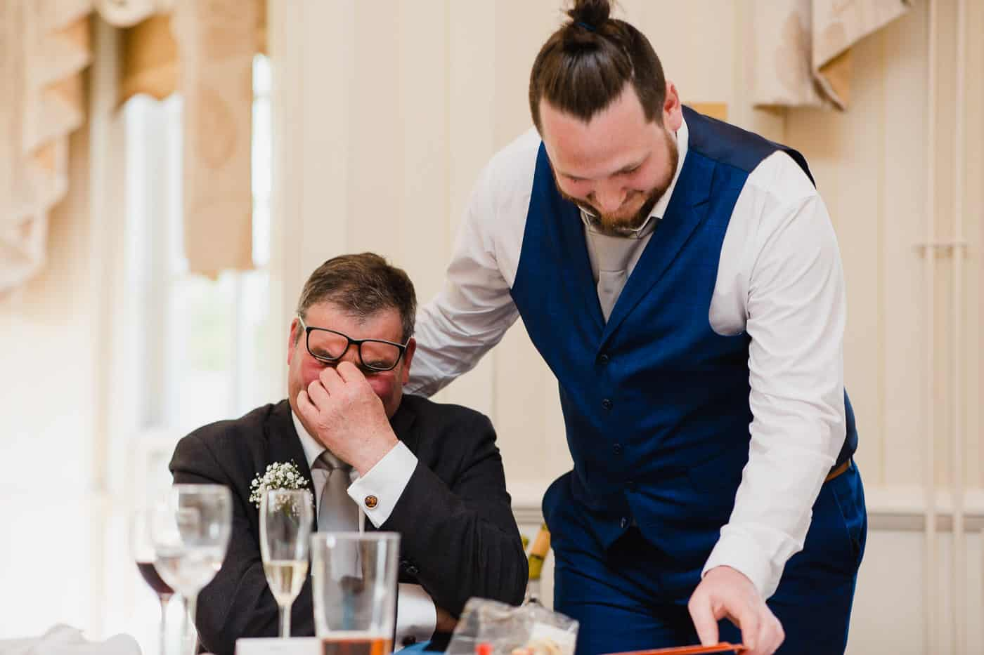father of groom laughing at wedding speeches de courceys manor