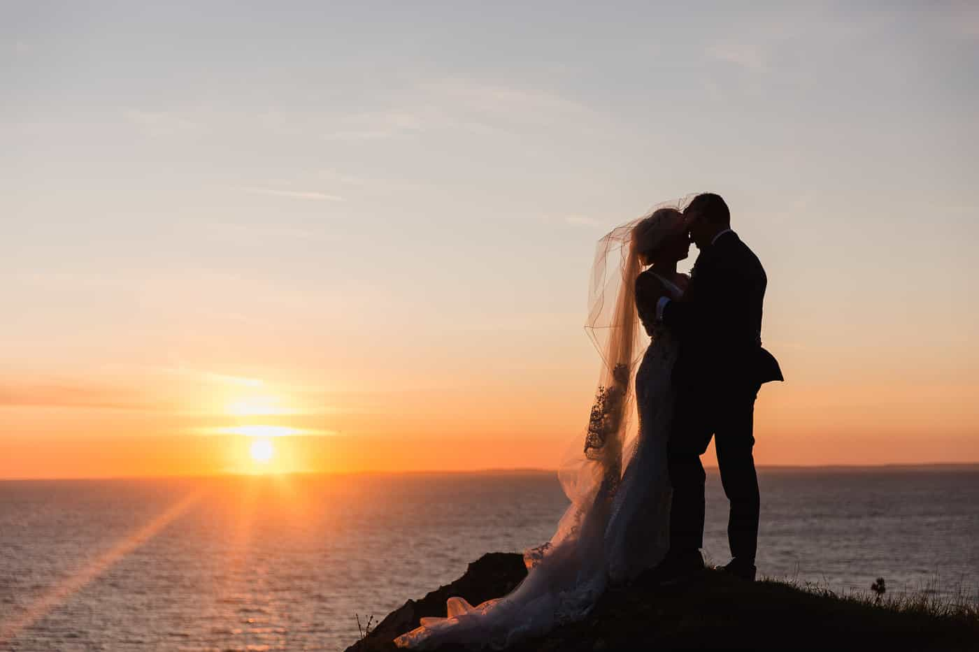 bride and groom portrait at sunset at rhossili bay