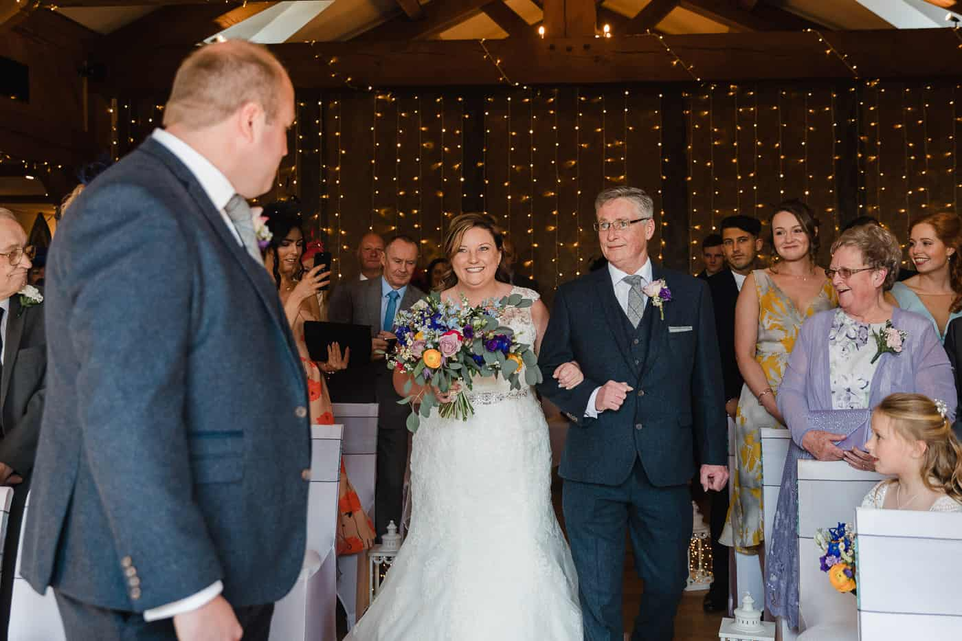 bride and father walking down aisle at king arthur hotel