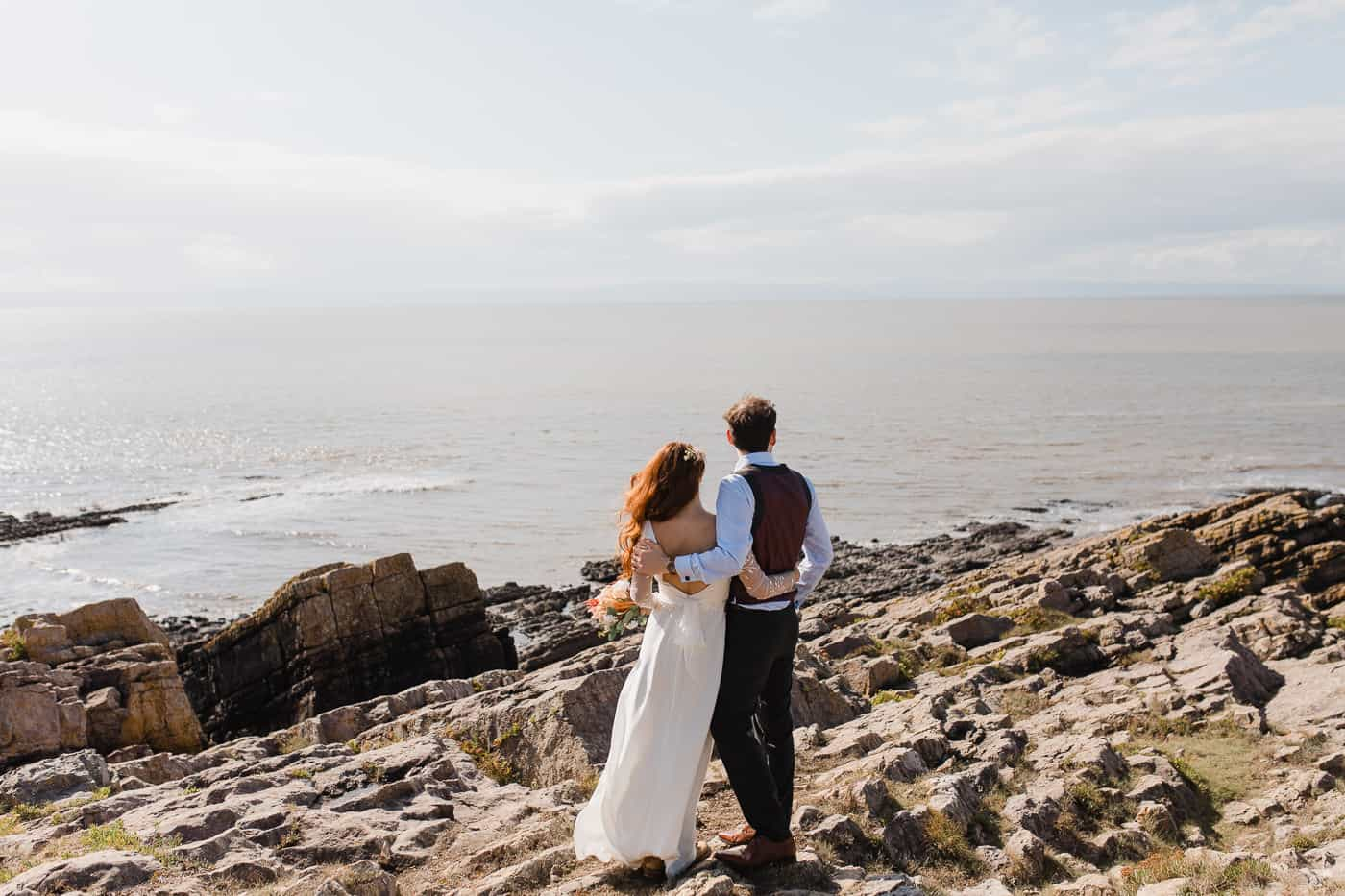 bride and groom looking at horizon