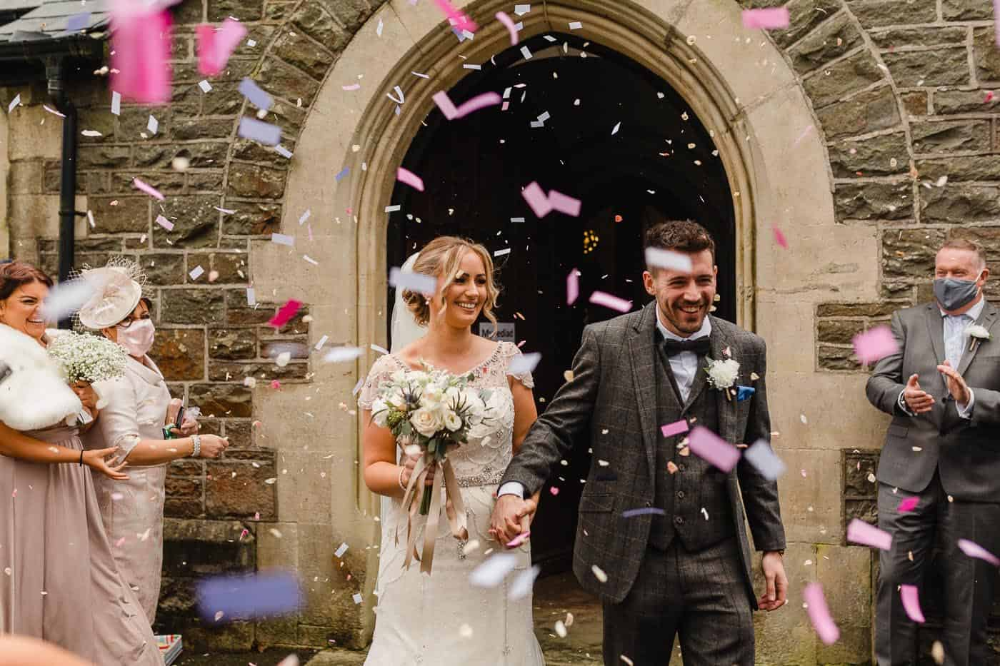bride and groom exit with confetti