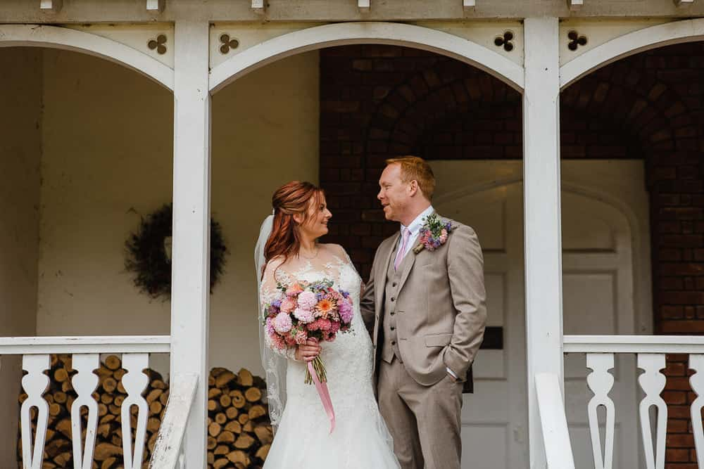 bride and groom in porch
